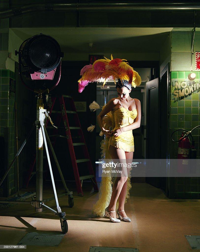 Showgirl adjusting costume backstage