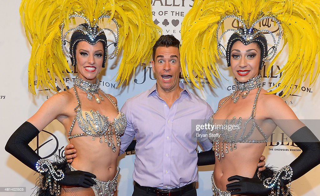 Showgirl Brittany Guinane, comedian/juggler Jeff Civillico and showgirl Taryn Olivieri arrive at the 'Jubilee!' show's grand reopening at Ballys Las Vegas on March 29, 2014 in Las Vegas, Nevada.