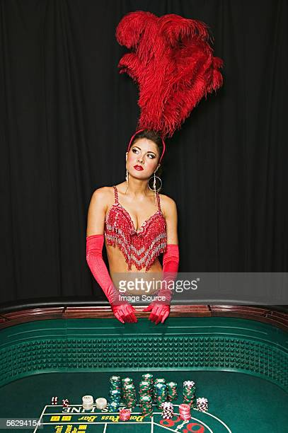 Showgirl daydreaming at craps table