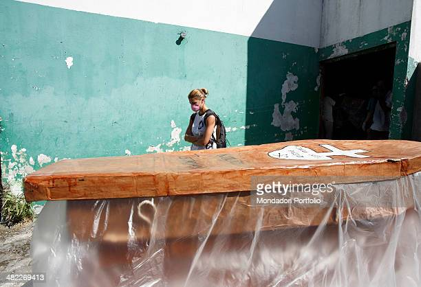 Showgirl Martina Colombari next to a coffin during a photo shoot about her visit to Haiti for NPH in January 2008