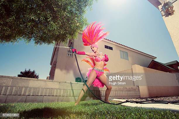 Showgirl watering lawn