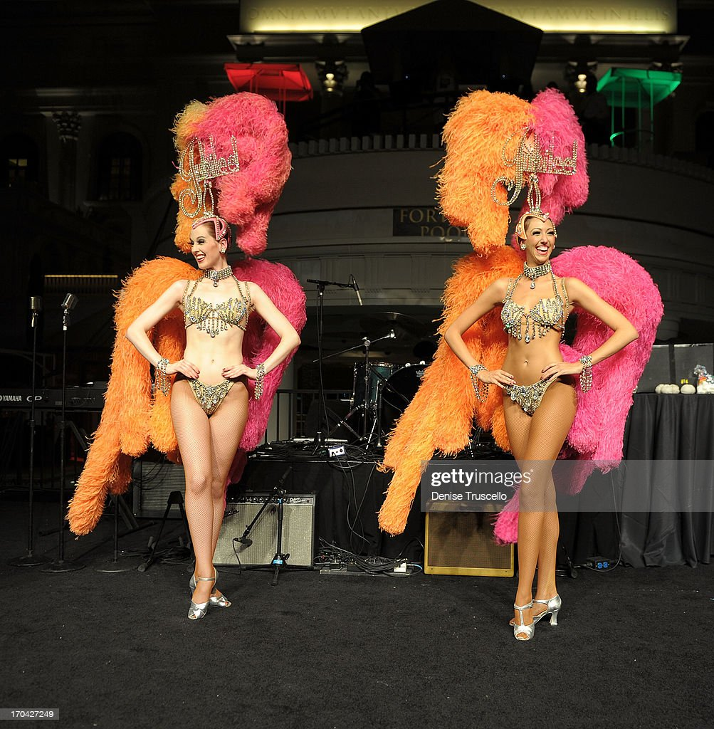 Showgirls from Bally's Las Vegas headliner Jubilee the closing night party for IPW 2013 at the Garden for the Gods pool at Caesars Palace on June 12, 2013 in Las Vegas, Nevada.