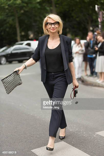 A showgoer carries a Goyard tote before Dior on Day 2 of Paris Haute Couture Fashion Week Autumn/Winter 2014 on on July 7 2014 in Paris France