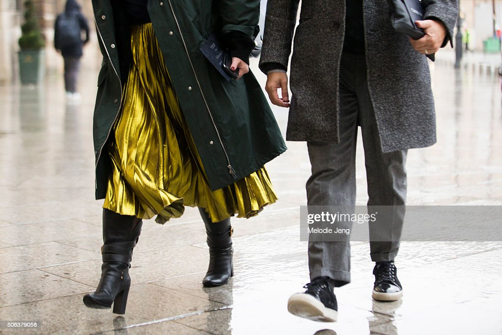 A showgoer wears a metallic gold Gucci cruise skirt on January 22 2016 in Paris France