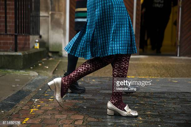 A showgoer wears Gucci metallic midheel pumps during London Fashion Week Autumn/Winter 2016/17 at Yeomanry House on February 20 2016 in London England