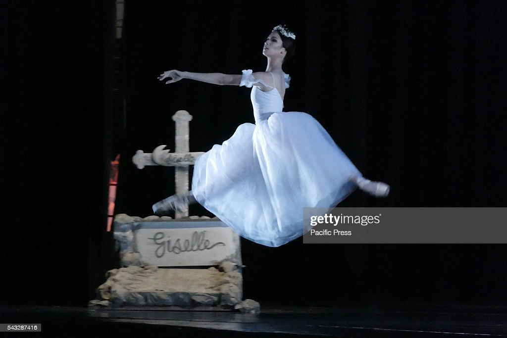 Showing grace while this ballerina performs her stunt with art The second part of the Giselle shows this scene where playful spirits at the grave of...