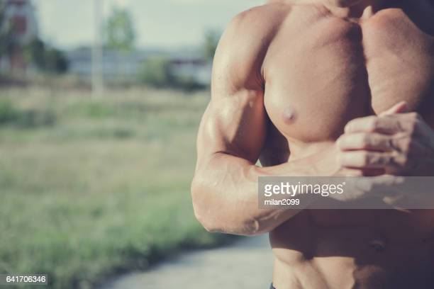 Showing his muscles