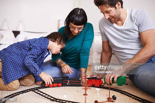 Showing his parents how to hitch the train