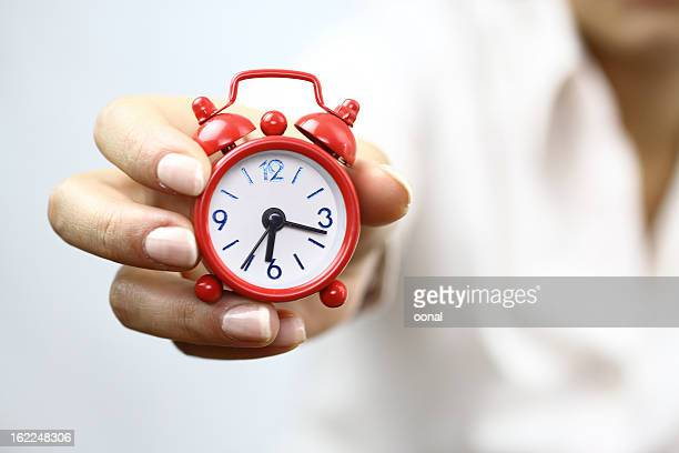 Showing red alarm clock