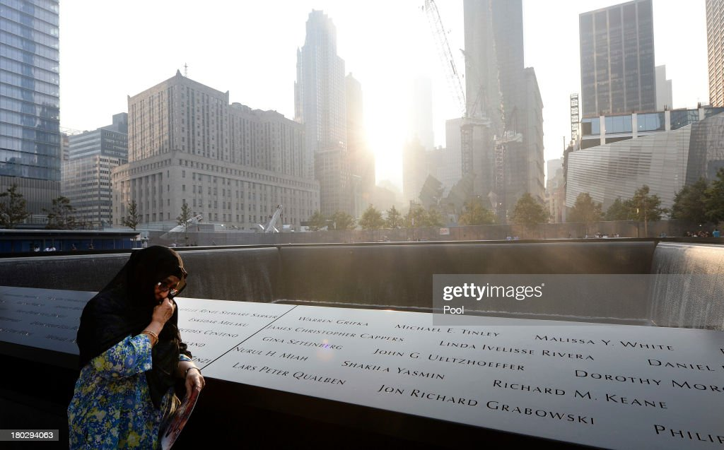 Showkatara Sharif, of Chantilly, Virginia, stands next to the engraving of her daughter's name, Shakila Yasmin, at the edge of the North Pool at the 9/11 Memorial during memorial ceremonies for the twelfth anniversary of the terrorist attacks on lower Manhattan on September 11, 2013 in New York City. The nation is commemorating the anniversary of the 2001 attacks which resulted in the deaths of nearly 3,000 people after two hijacked planes crashed into the World Trade Center, one into the Pentagon in Arlington, Virginia and one crash landed in Shanksville, Pennsylvania. Following the attacks in New York, the former location of the Twin Towers has been turned into the National September 11 Memorial & Museum.