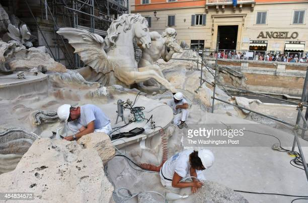 Shown are workers restoring the Trevi Fountain on August 20 2014 in Rome Italy Italy is getting financial help from corporations to help with the...