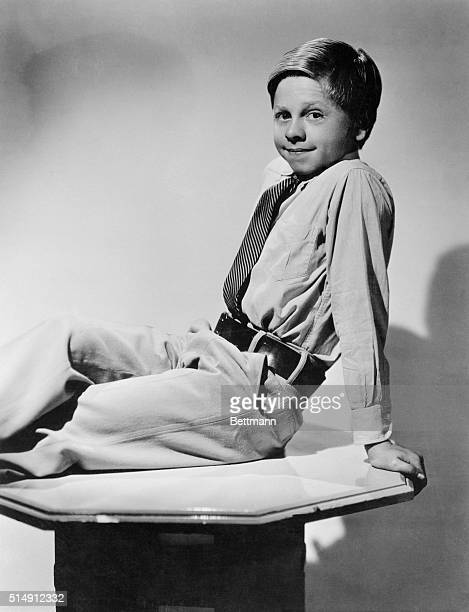 Shown here reclining on a table top is MGM player Mickey Rooney