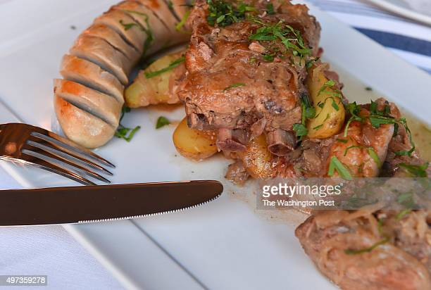 Shown is the Choucroute consisting of Boudin Blanc braised and smoked pork and tarragon mustard at L'Hommage Bistro Francais on October 21 2015 in...