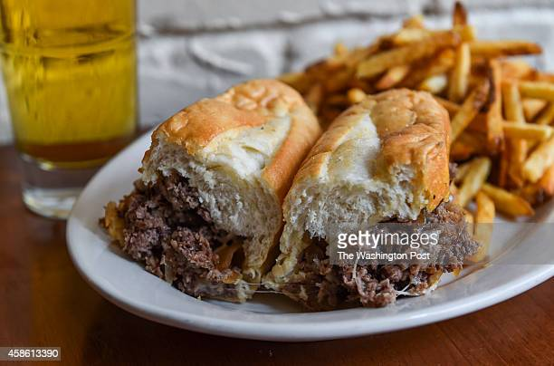 Shown is the Philly cheesesteak sandwich served with sautéed onions and provolone cheese with the hand cut fries at 82 Steak Out on November 3 2014...