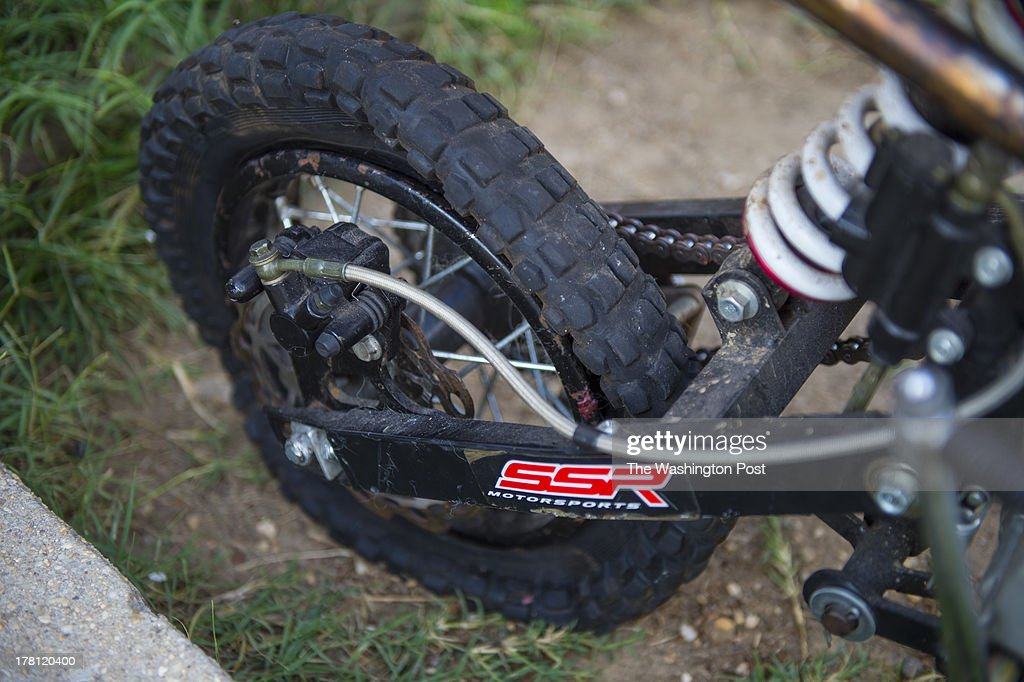 Shown is the rear wheel of Don Whitaker's, 19, SSR 110 dirt bike in Southeast on August 22, 2013 in Washington, D.C. Don claims that he was targeted by police when he was purposely hit by an unmarked Metropolitan Police car while riding his motorbike in the street. The rear wheel was damaged and he sustained minor injuries. Several riders have filed a class action lawsuit against the police department for their actions against motorbike riders.