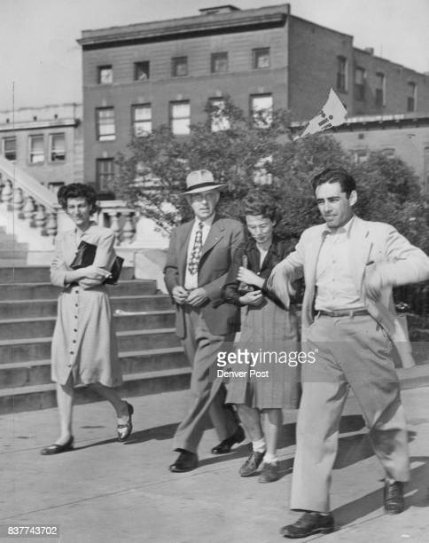 Shown outside the postoffice building on their way to district court are four persons figuring in the Denver investigation of Communist activities...