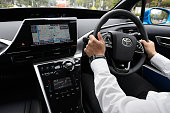 A showroom staff member drives a Toyota Motor Corp Mirai fuelcell powered vehicle in Tokyo Japan on Friday April 17 2015 Toyota the world's largest...