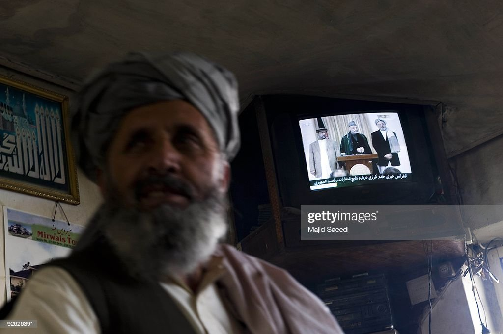A TV shows Afghan President <a gi-track='captionPersonalityLinkClicked' href=/galleries/search?phrase=Hamid+Karzai&family=editorial&specificpeople=121540 ng-click='$event.stopPropagation()'>Hamid Karzai</a> attending a press conference at the Presidential Palace on November 3, 2009 in Kabul, Afghanistan. Re-elected Karzai promised his new government would stop corruption and engage with Taliban insurgents,