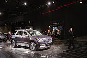GMC shows off their Acadia Denali luxury crossover SUV during the media preview at the North American International Auto Show on January 13 2015 in...