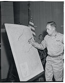 Shows Where it Happened Tachikawa Air Force Base Japan Captain Elmer F Llewellyn one of the 11 US fliers freed by Red China traces the route of the...