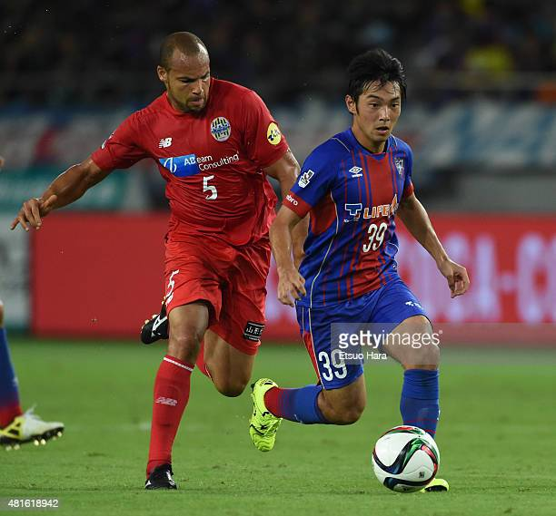 Shoya Nakajima of FC Tokyo and Alceu of Montedio Yamagata compete for the ball during the JLeague match between FC Tokyo and Montedio Yamagata at...
