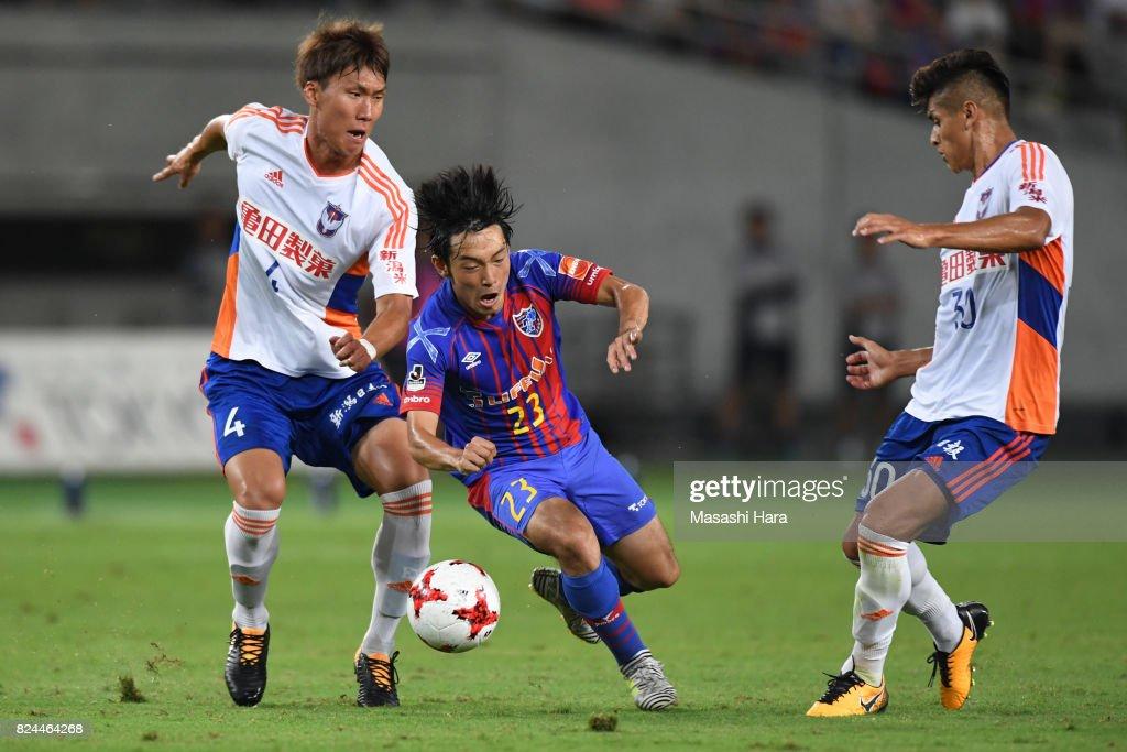 Shoya Nakajima of FC Tokyo and Song Ju Hun of Albirex Niigata compete for the ball during the J.League J1 match between FC Tokyo and Albirex Niigata at Ajinomoto Stadium on July 30, 2017 in Chofu, Tokyo, Japan.