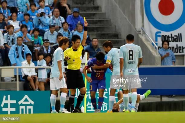 Shoya Nakajima of FC Tokyo is shown a yellow card by referee Yudai Yamamoto during the JLeague J1 match between Jubilo Iwata and FC Tokyo at Yamaha...