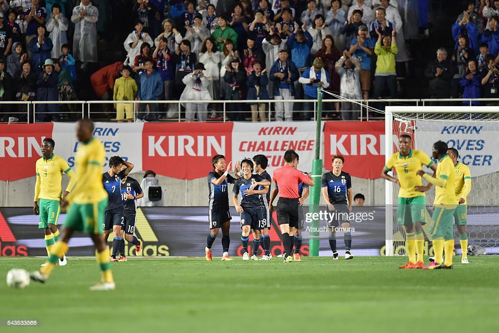 <a gi-track='captionPersonalityLinkClicked' href=/galleries/search?phrase=Shoya+Nakajima&family=editorial&specificpeople=7882598 ng-click='$event.stopPropagation()'>Shoya Nakajima</a> (C) of Japan celebrates scoring his team's first goal during the U-23 international friendly match between Japan and South Africa at the Matsumotodaira Football Stadium on June 29, 2016 in Matsumoto, Nagano, Japan.