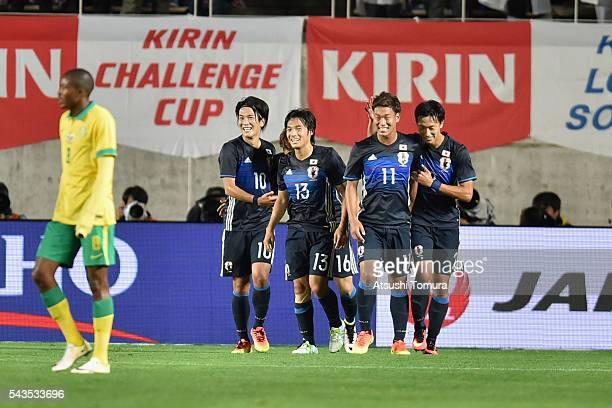 Shoya Nakajima of Japan celebrates scoring his team's third goal with his team mates during the U23 international friendly match between Japan and...