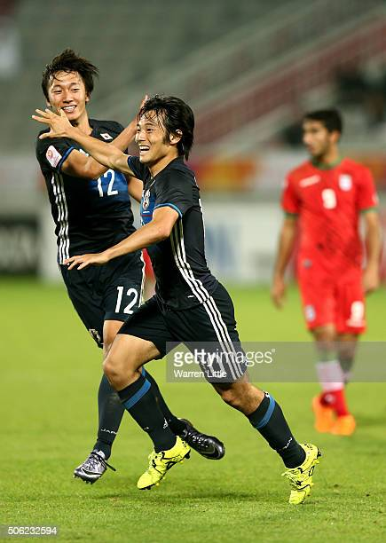 Shoya Nakajima of Japan is congratulated by team mate Sei Muroya after scoring a goal in extra time during the AFC U23 Championship quarter final...