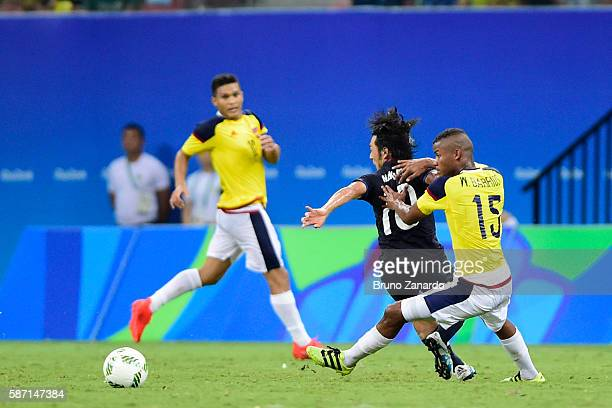 Shoya Nakajima player of Japan competes for the ball with Wilmar Barrios player of Colombia during 2016 Summer Olympics match between Japan and...