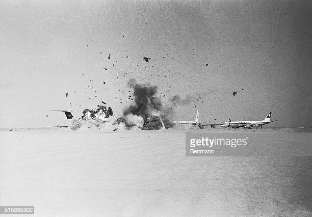 Shrapnel smoke and desert dust erupt on this desolate airstrip as one of three BOAC VC10 jetliners hijacked by Arab guerrillas blows up All three...