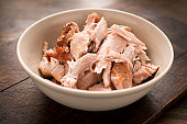 Shredded cooked chicken in a bowl