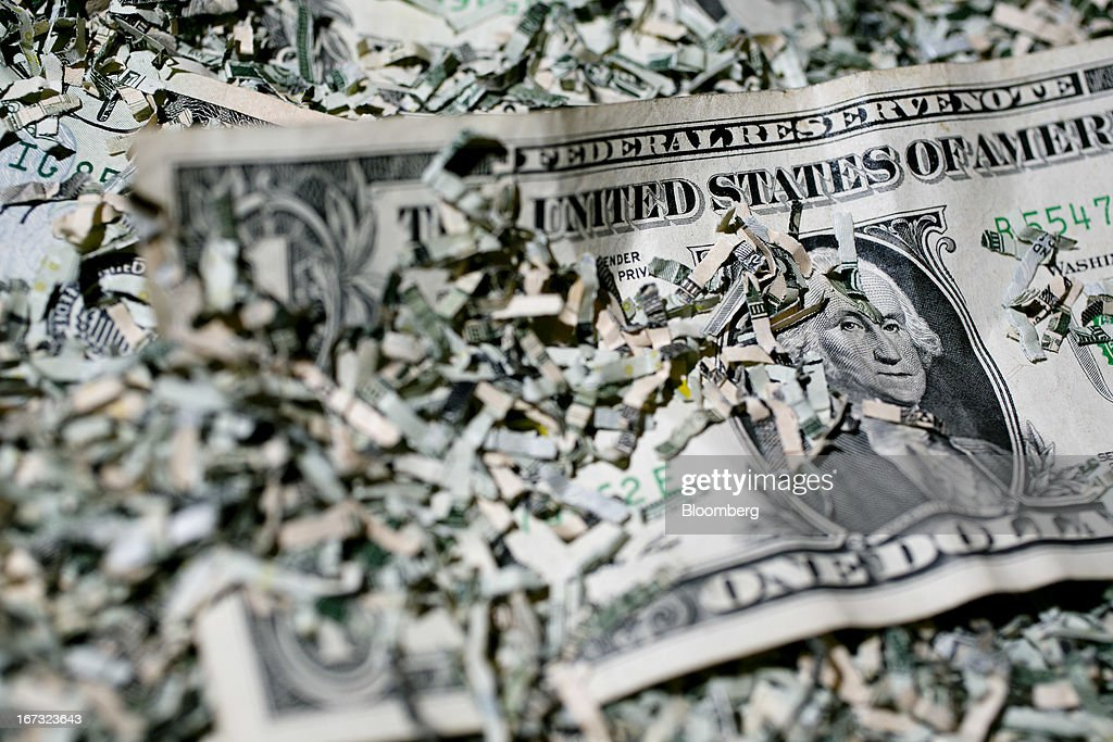 Shredded currency surrounds a U.S. one dollar bill in Washington, D.C., U.S., on Wednesday, April 24, 2013. The S&P 500 has surged 134 percent from a 12-year low in 2009 as corporate earnings beat estimates and the Federal Reserve embarked on three rounds of bond purchases to stimulate the economy. Photographer: Andrew Harrer/Bloomberg via Getty Images