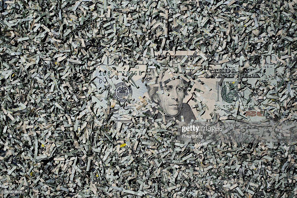 Shredded currency surrounds a U.S. twenty dollar bill in Washington, D.C., U.S., on Wednesday, April 24, 2013. The S&P 500 has surged 134 percent from a 12-year low in 2009 as corporate earnings beat estimates and the Federal Reserve embarked on three rounds of bond purchases to stimulate the economy. Photographer: Andrew Harrer/Bloomberg via Getty Images