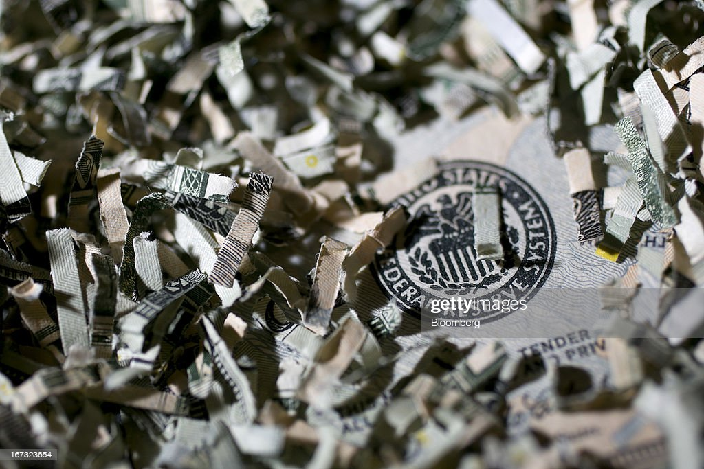 Shredded currency surrounds the seal of the U.S. Federal Reserve in Washington, D.C., U.S., on Wednesday, April 24, 2013. The S&P 500 has surged 134 percent from a 12-year low in 2009 as corporate earnings beat estimates and the Federal Reserve embarked on three rounds of bond purchases to stimulate the economy. Photographer: Andrew Harrer/Bloomberg via Getty Images
