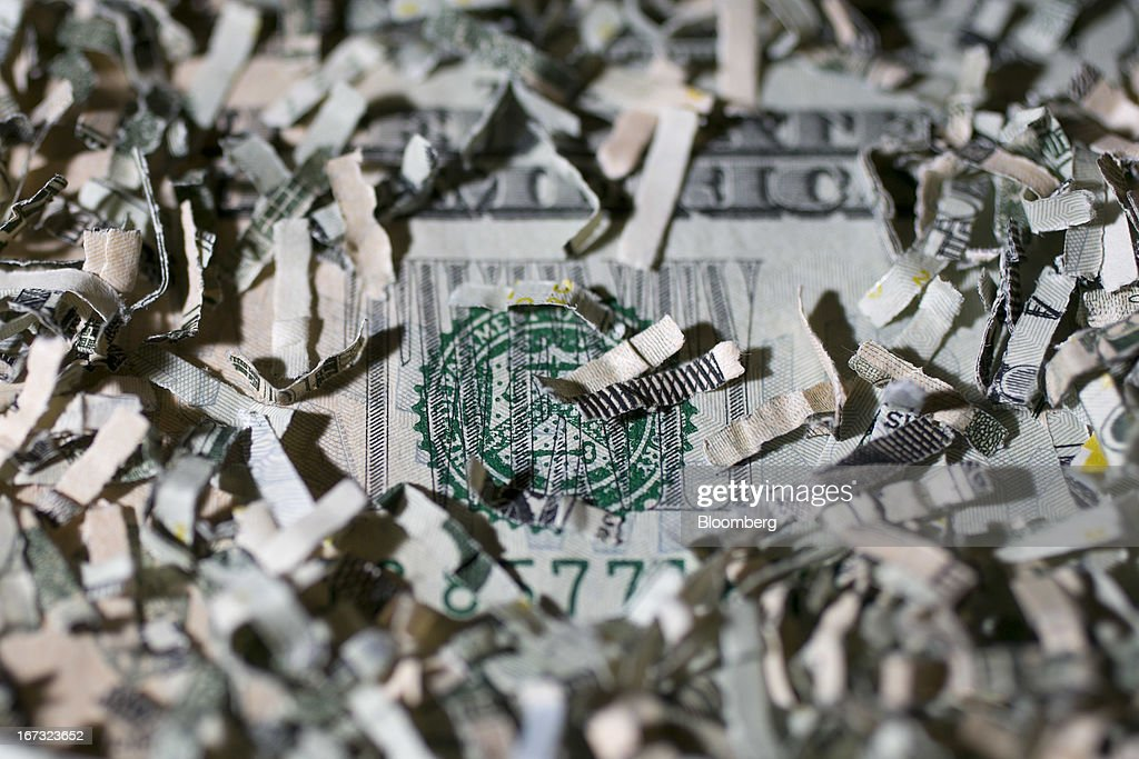 Shredded currency surrounds the seal of the U.S. Treasury on a twenty dollar bill in Washington, D.C., U.S., on Wednesday, April 24, 2013. The S&P 500 has surged 134 percent from a 12-year low in 2009 as corporate earnings beat estimates and the Federal Reserve embarked on three rounds of bond purchases to stimulate the economy. Photographer: Andrew Harrer/Bloomberg via Getty Images