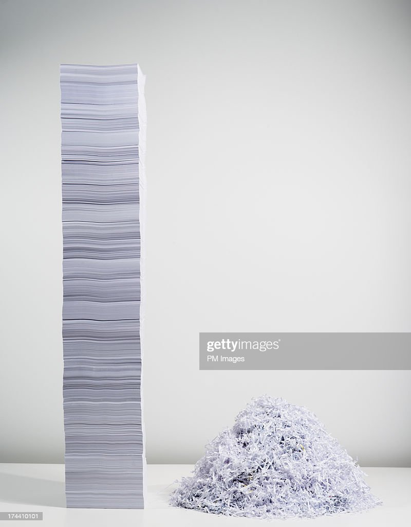 Shredded paper and stack of paper