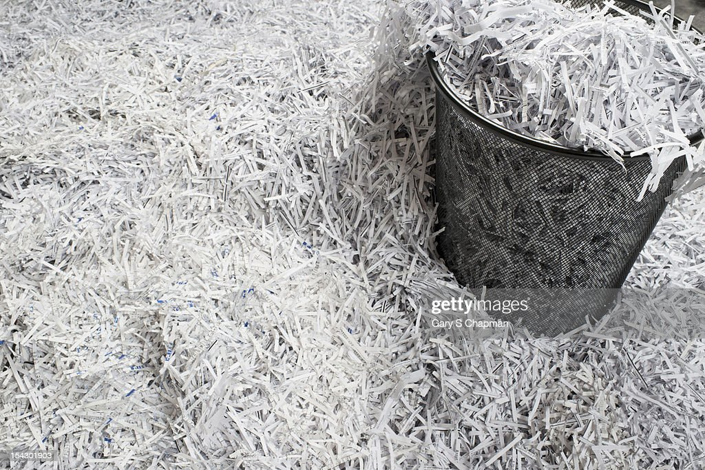 Shredded paper documents and waste paper basket : Stock Photo