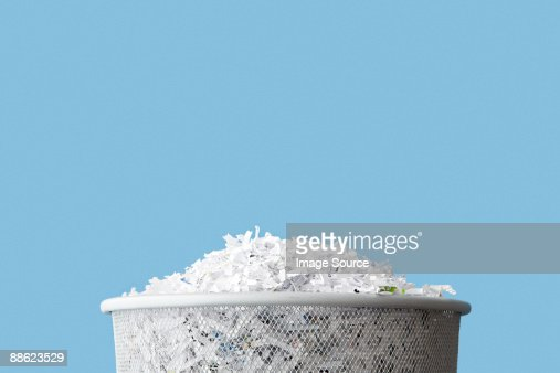 Shredded paper in a bin