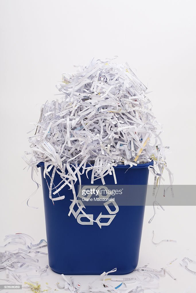 Shredded paper in a recycle bin : Stock Photo