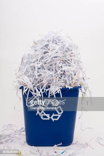 Shredded paper in a recycle bin : Bildbanksbilder