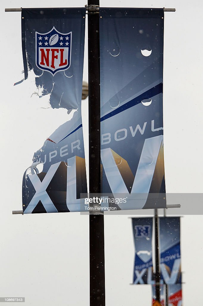A shredded Super Bowl XLV banner hangs on a light pole at DFW International Airport on February 1, 2011 in Dallas, Texas. A major ice storm hit the Dallas/Fort Worth area overnight days before Super Bowl XLV is to be be held in Arlington, Texas.