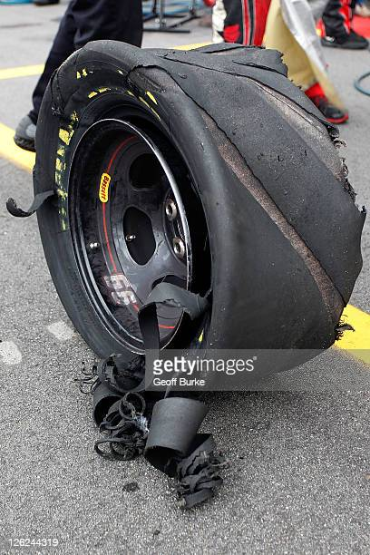 A shredded tire off the Varischetti Sons Chevrolet sits in behind the pit wall during the NASCAR KN Series New Hampshire 125 at New Hampshire Motor...