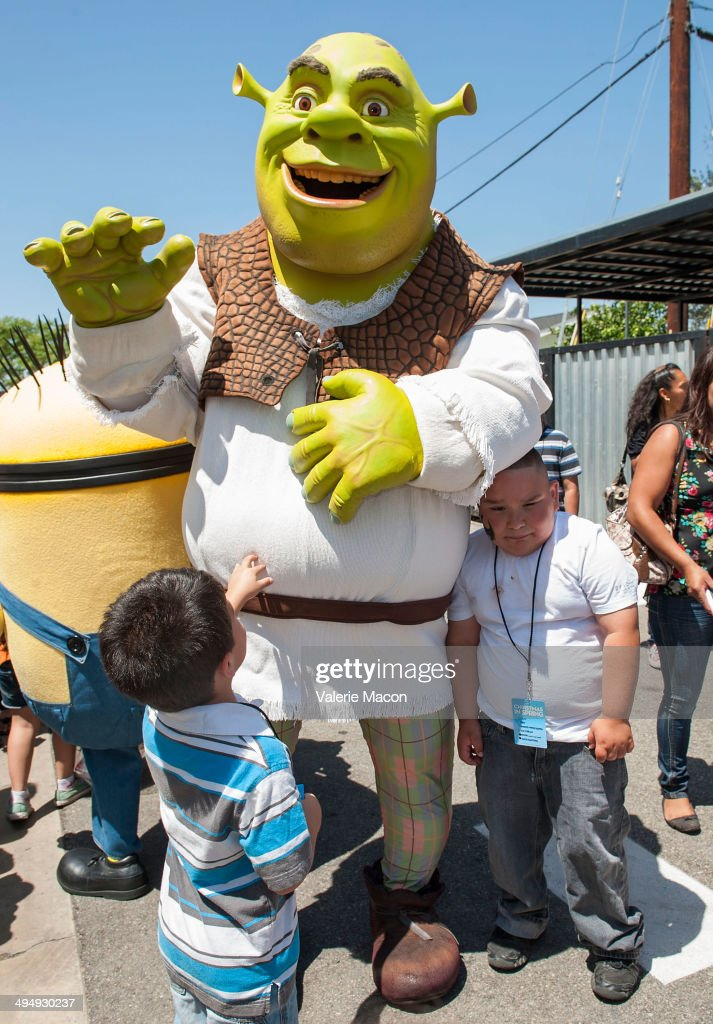 Shrek attends Universal Studios Hollywood 23rd Annual 'Christmas In Spring' Charity Event at M.E.N.D Transitional Living Center on May 31, 2014 in Pacoima, California.