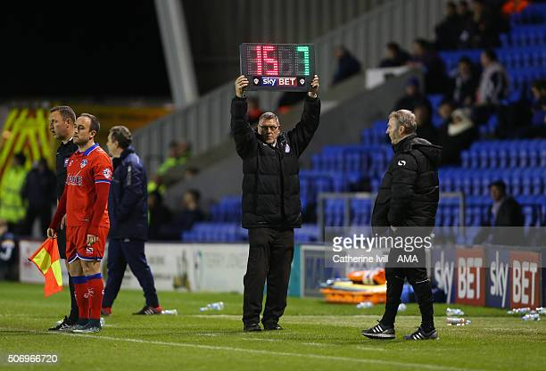 Shrewsbury Town chief steward holds up the substitutes board after he takes over the role as 4th official during the Sky Bet League One match between...
