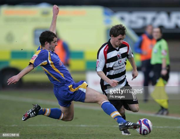 Shrewsbury Town's Darren Moss and Darlington's Robert Purdie during the CocaCola League Two match at the ProStar Stadium Shrewsbury
