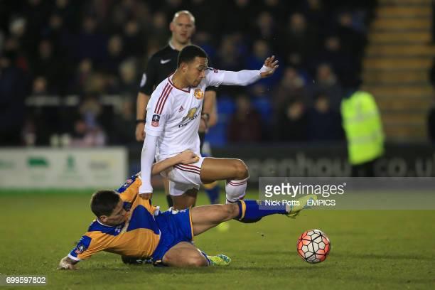 Shrewsbury Town's Ian Black Manchester United's Memphis Depay battle for the ball