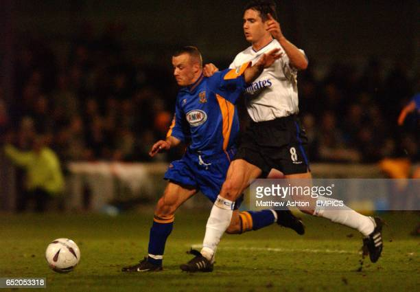 Shrewsbury Town's Luke Rodgers and Chelsea's Frank Lampard battle for the ball