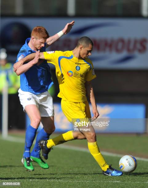 Shrewsbury Town's Matt Harrold and Wycombe Wanderers's Lewis Montrose battle for the ballduring the npower Football League Two match at the Prostar...